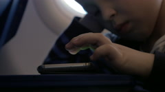 Close up view of small boy playing with smartphone on the table Stock Footage