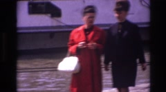 1967: two women walking and talking alongside the lake. FRANCE Stock Footage