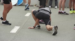 Athlete on marathon prepearing for race Stock Footage
