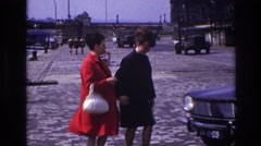 1967: two women dressed up to go out are getting into a car for a drive. FRANCE Stock Footage