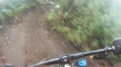 POV of teenage boy mountain biking in a forest. Stock Footage