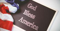 Composite image of god bless america Stock Photos