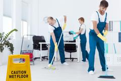 Cleaners mopping floor Stock Photos