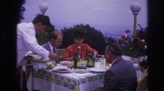 1967: the waiter serving food to the people at the table in the restaurant Stock Footage