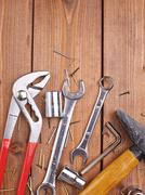 Set of different work tools on wooden surface Stock Photos