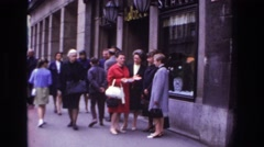 1967: classic dressed women are walking in the street FRANCE Stock Footage