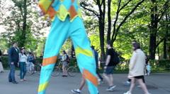 Street Artist on Stilts Entertains Surprised Pedestrians Stock Footage