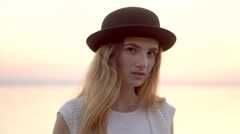 Close up portrait of pretty woman at sunset sea background Stock Footage