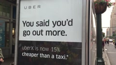 NEW YORK CITY: Uber app advertisement ride sharing, disruption, Stock Footage