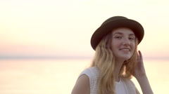 Close up portrait of pretty woman smiling at sunset sea background Stock Footage