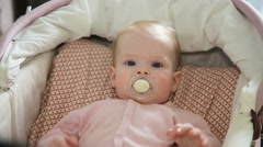 Cute little baby with pacifier Stock Footage
