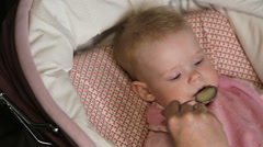 Mother feeding her baby by spoon Stock Footage