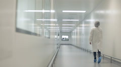 Lab Technician Walking Down Corridor Stock Footage