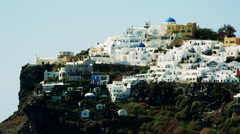 White houses line the hillsides of the Greek Island of Santorini Stock Footage