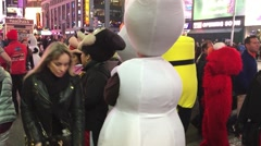 NEW YORK CITY: Times Squares costumed mascots cartoon characters Stock Footage