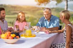 Leisure time - family playing cards. Stock Photos