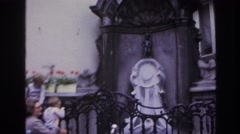 1967: water fountain outside of historic building is an interesting conversation Stock Footage