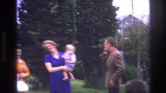 1967: families park children playing talking lady holding child running around Stock Footage
