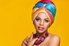 Gorgeous afro-american girl in national turban Stock Photos