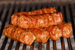"""Traditional food Meat Balls """"mici"""" on grill Stock Photos"""