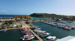 Aerial overview shot of boats and resort at Spanish Water in Curacao Stock Footage