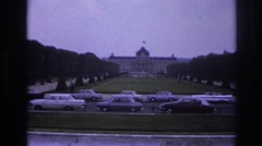 1967: a very well situated building precisely spaced between two rows of trees. Stock Footage