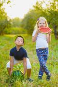 Funny kids taste watermelon. Child Healthy Eating Stock Photos