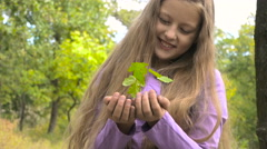 Girl holding a small plant Stock Footage