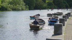 Boatman getting off the water inside the boat Ireland Stock Footage