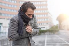 Man casual dressed in the city on a  winter seasonal day Stock Photos