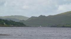 Big ocean with a small boat in Sligo Ireland Stock Footage