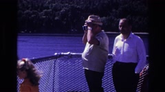 1967: old man on board looking through binocular and later joins a lady OTTAWA Stock Footage
