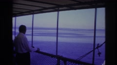 1967: vast sea people on shore enjoying watching amazing sight wonderful weather Stock Footage