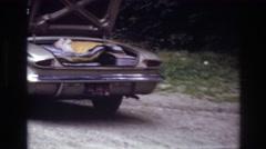 1967: three people having a roadside picnic near their parked car OTTAWA CANADA Stock Footage