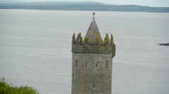 The small Doonagore Castle along the road Ireland Stock Footage