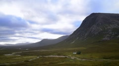 White cottage in front of Buachaille Etive Mor, Glen Coe, Highlands, Scotland Stock Footage