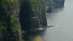 The sea and the rocks kissing in Moher Cliffs Ireland Stock Footage