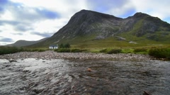 Lagangarbh Hut in front of Buachaille Etive Mor in Glen Coe, Scotland Stock Footage