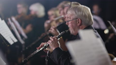 4K Symphony orchestra during a performance with focus on oboist Stock Footage