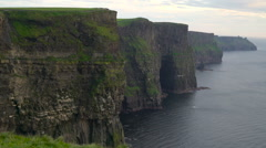 The side view of the Moher Cliffs and the sea Ireland Stock Footage