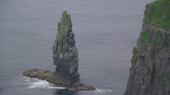 Small rock formation in the sea in Moher Cliff Ireland Stock Footage