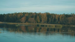 Autumn scenery on the pond. The tranquility and balance. Autumn colors. Stock Footage