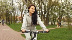 Beautiful girl riding a bike Stock Footage