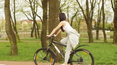 The girl pedaling on a bicycle Stock Footage