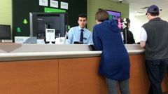 Motion of people at service counter talking to the teller inside TD Bank. Stock Footage
