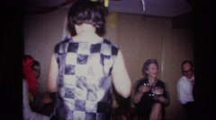 1967: family enjoying a costume party indoors. OTTAWA CANADA Stock Footage