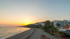 Sunset on the beach of nerja spain in 4k Stock Footage