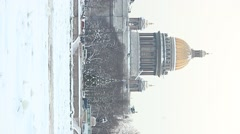 Vertical view of Saint Isaac Cathedral from opposite bank of Neva river, winter Stock Footage