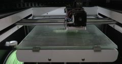 Close-up view of mechanism of 3d printer making white plastic object Stock Footage