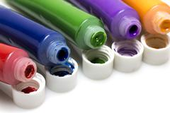 Tubes of colorful oil paint on white Stock Photos